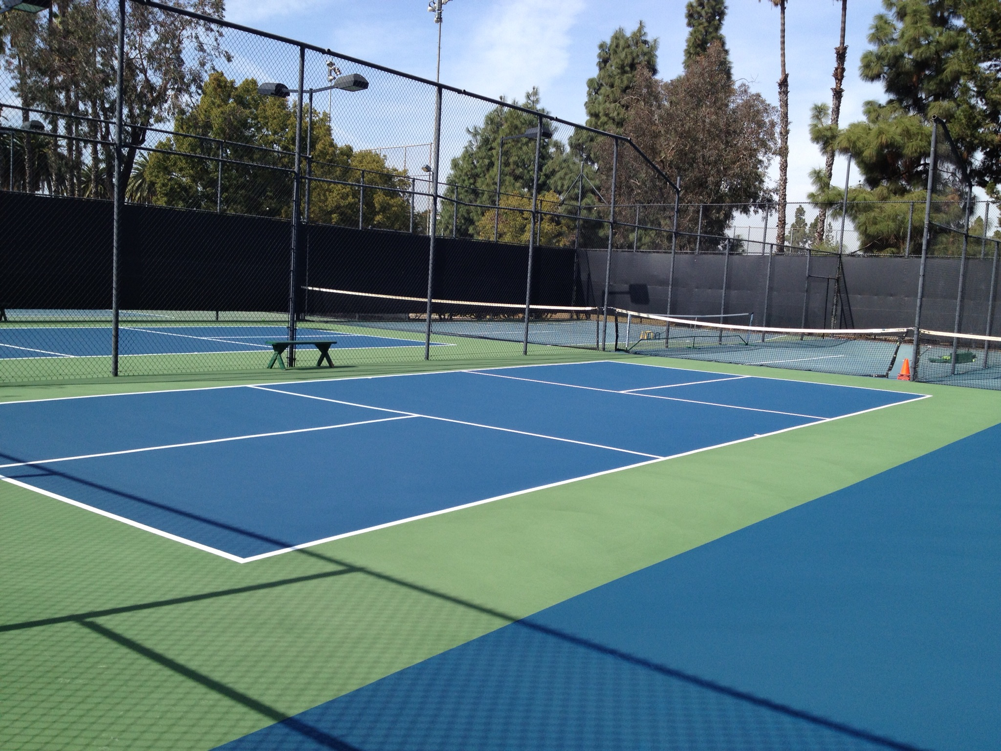 Can pickleball be played on a tennis court for How much does a half court basketball court cost