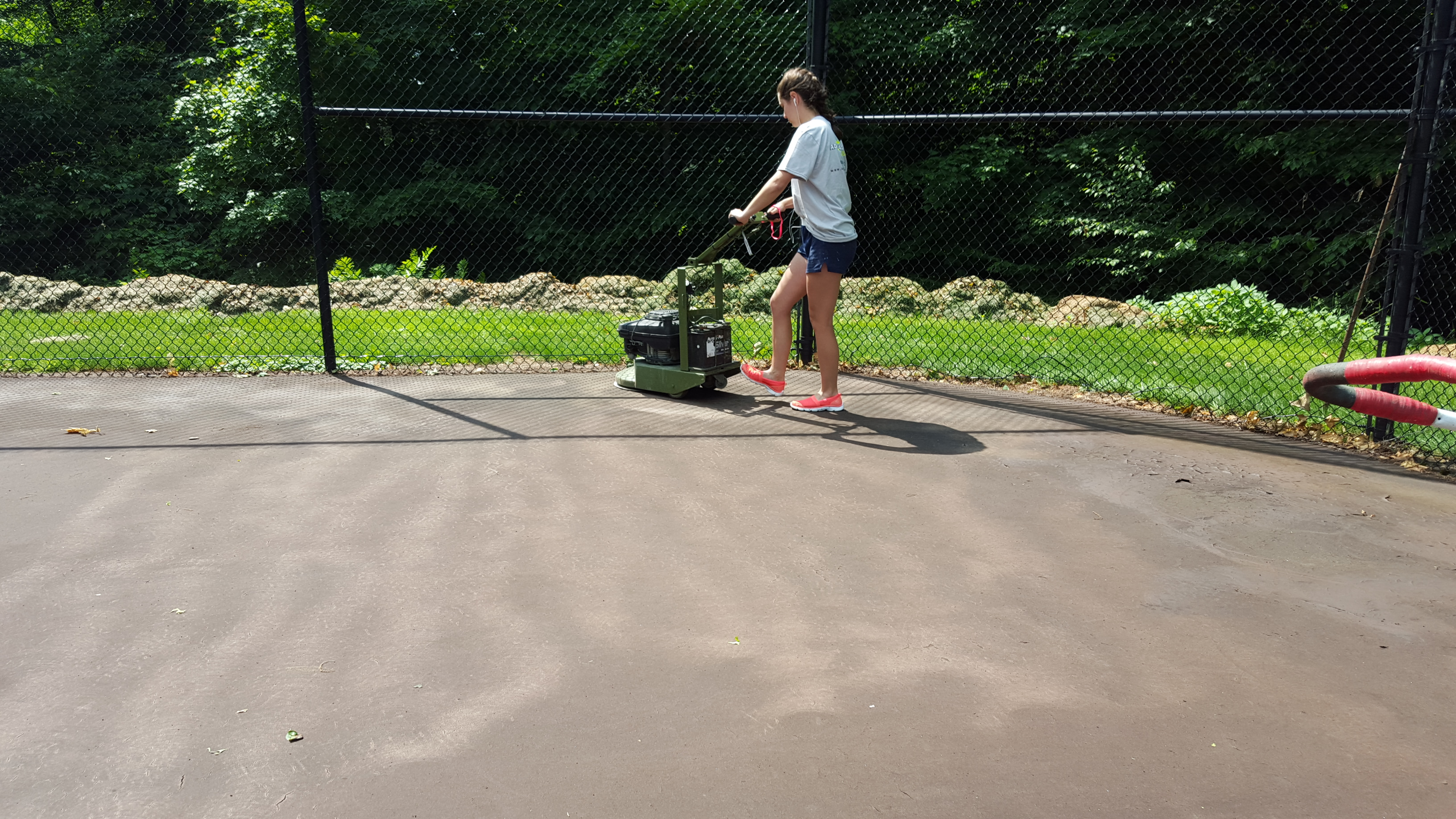Sanding A Tennis Court Surface