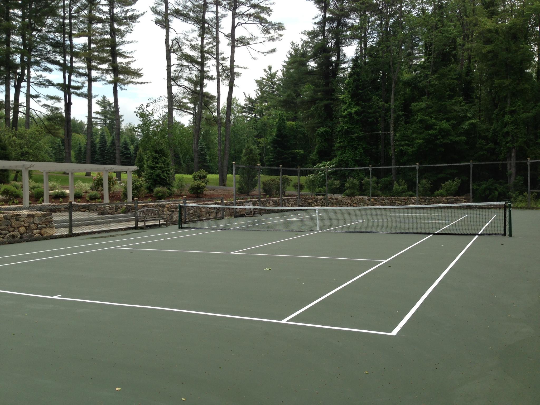 Tennis court construction backyard court builders for Cout autoconstruction