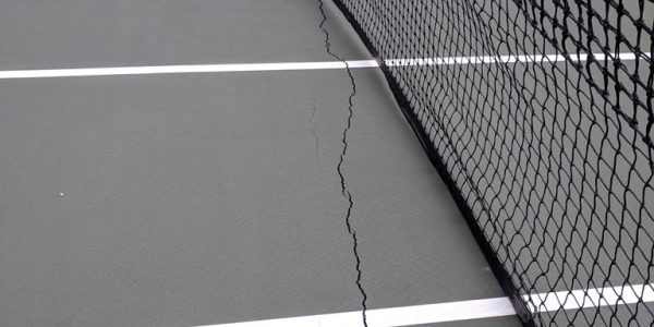Asphalt Tennis Court Crack Under Net