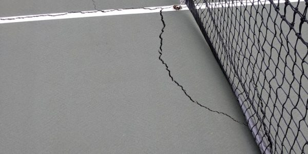 Tennis Court Cracks Under Net